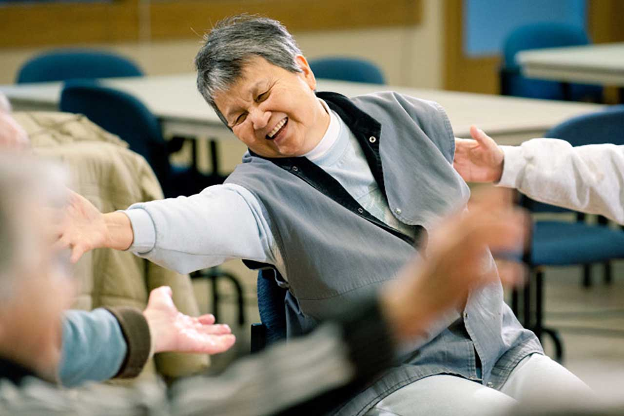 movement class for people with parkinsons sitting in chairs